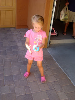 Young girl holding blue ball