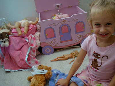 Young girl sitting in room playing with toys