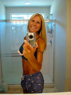Woman showing off arm band tattoo in mirror