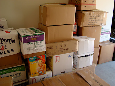Stacked moving boxes against wall