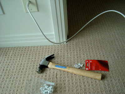 Hammer and supplies on carpet