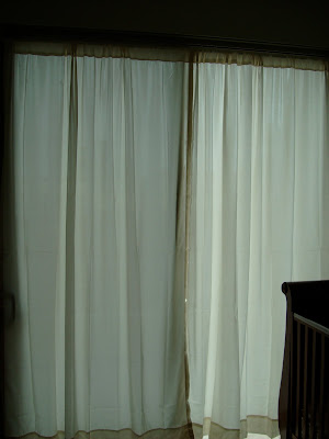 Curtains on windows in room