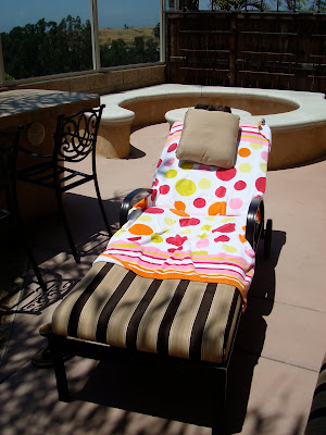 Lounge chair with towel and pillow