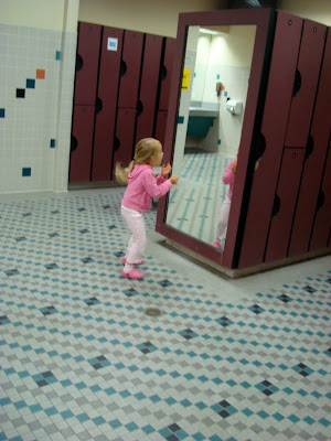 Young girl dancing in front of mirror