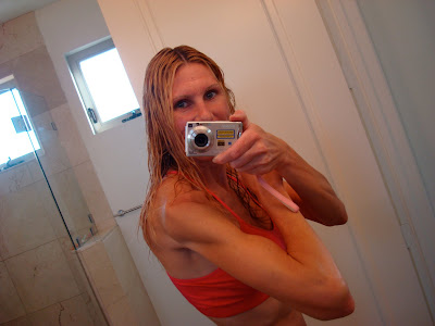 Woman flexing in front of mirror