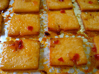 Close up of flipped tofu in oven