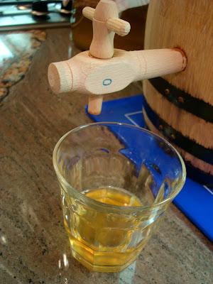 Barrel tap over glass of kombucha