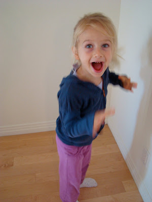 Young girl doing a scary monster face