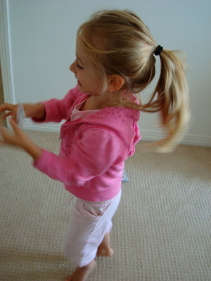 Side view of little girl standing in bedroom