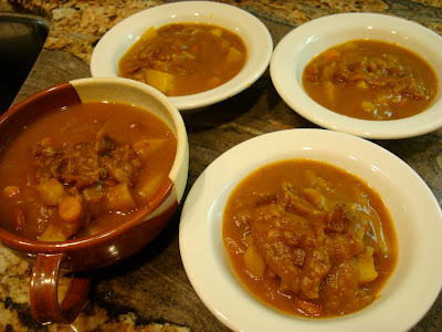 Savory Pumpkin, Potato, and Carrot Soup portioned into four bowls