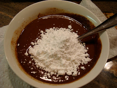 Powdered sugar added to frosting mixture
