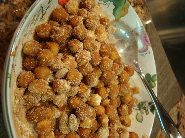 Chickpeas tossed up in dry ingredients