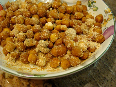 """Close up of Cinnamon Sugar Peanut Buttery Chickpea """"Peanuts"""" with Peanut Flour in dish"""