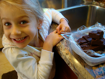 Young girl smiling in front of Chocolate Peanut Butter Fudge