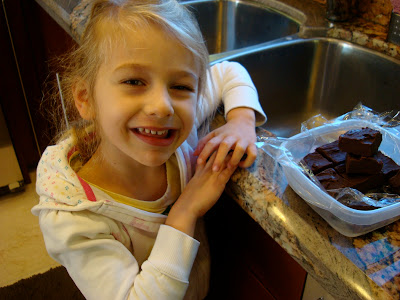 Chocolate Peanut Butter Fudge with young girl smiling