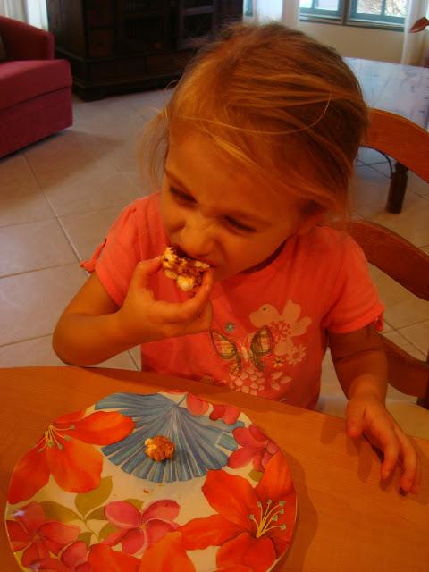 Little girl eating one bar