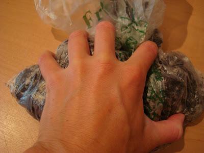 Hand crushing Oreos