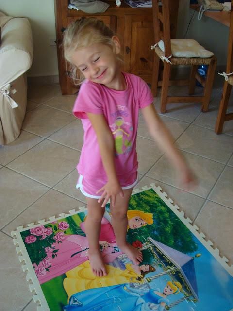 Young girl standing on princess mat