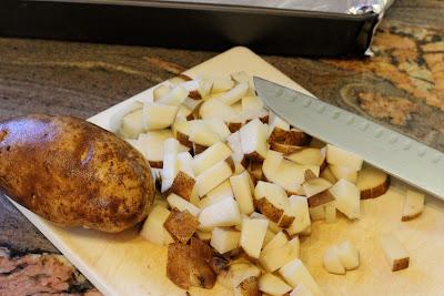 Dicing potatoes on cutting board