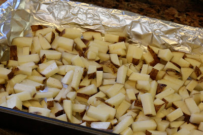 Foil lined pan of potoatoes