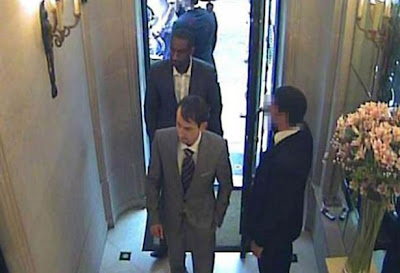 An image from CCTV footage of two smartly-dressed armed robbers entering Graff Jewellers in London's West End