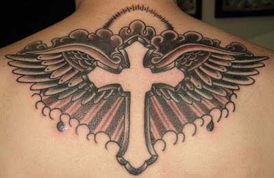 Tiny cross with wing tattoo.