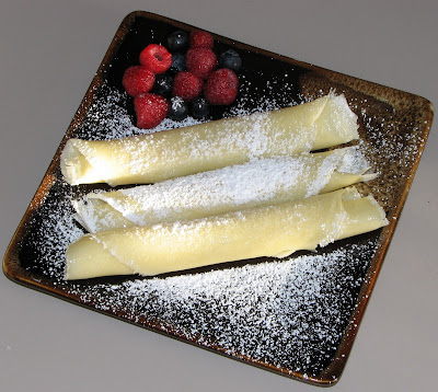 Crepes with Melted Butter and Powdered Sugar