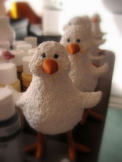 chick sculptures waiting to be painted