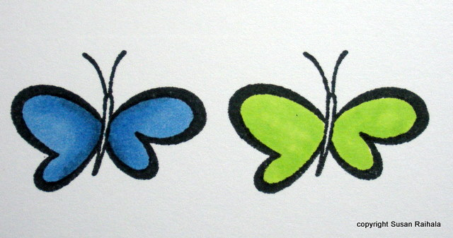 note the blue butterfly is finished the green one just has one layer of light green sharpie