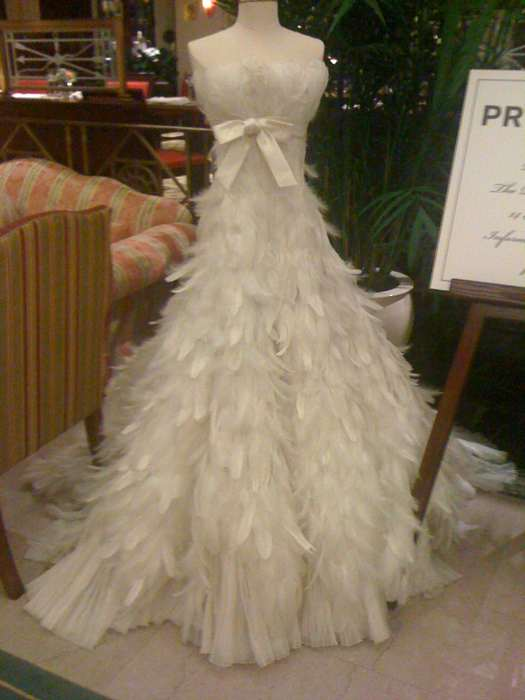 Wedding event planning decor floral design for White feather wedding dress