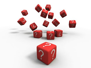 dice with question marks instead of numbers