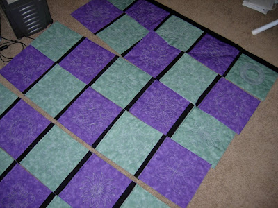 assembling rows in reversible embroidered quilt