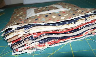 A pile of Paintbox quilt along blocks