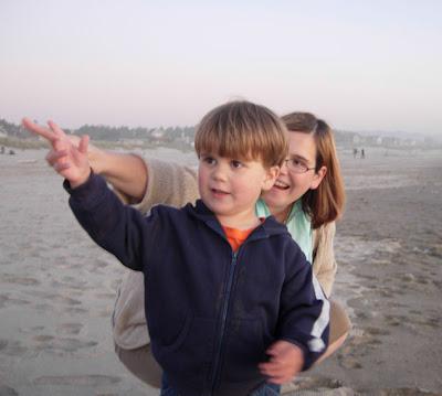 mama and boy on beach