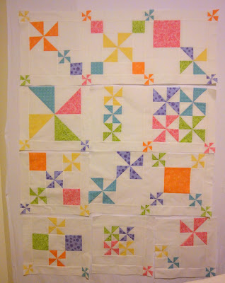 Pinwheel Party quilt on the design wall