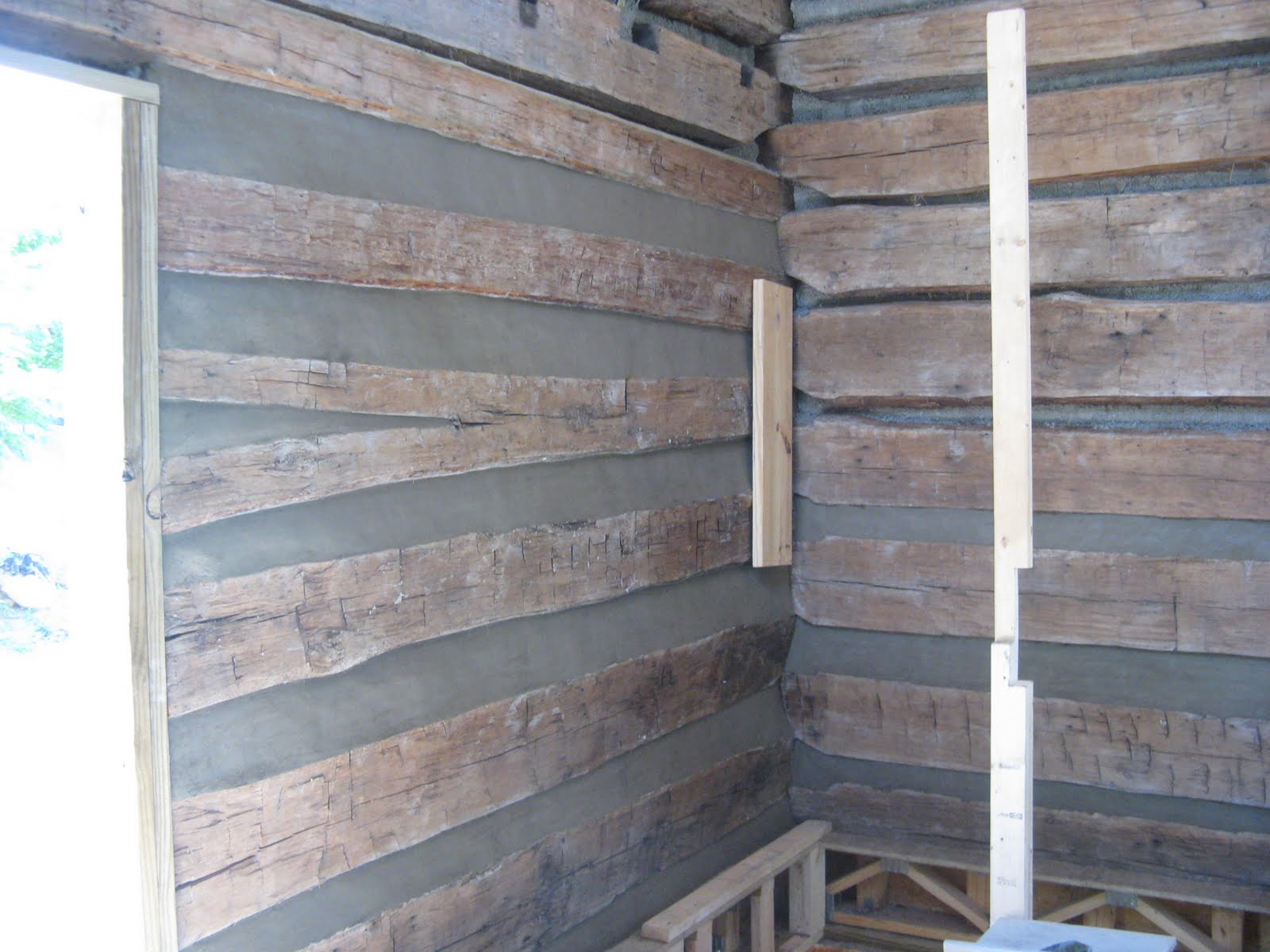 Old Log Cabin Revival: Inside Chinking and Framing in the Gable