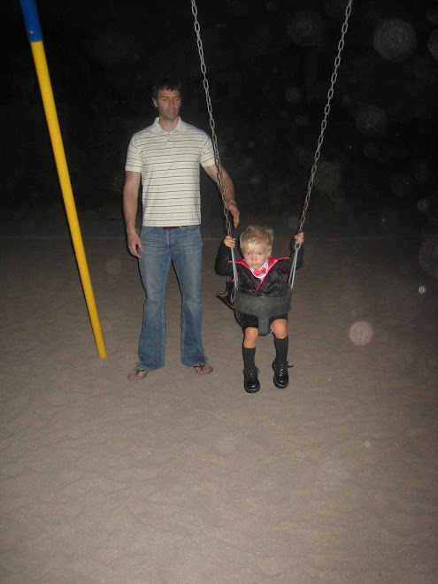 Daddy pushing him on the swing (I love the socks)