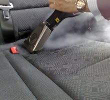Again Using The Triangular Brush With Microfibre Move Tool Vertically And Horizontally On Car Seats Steam Cleaner Will Remove Dirt Stains