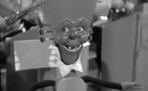 Anthropomorphic guitar puppet