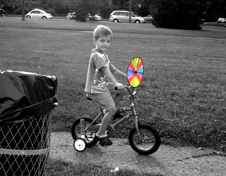 rainbow twirl, kid riding bike