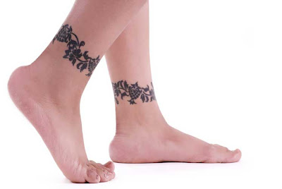 She has also a small flower tattoo above her right foot. Ankle Tattoos For
