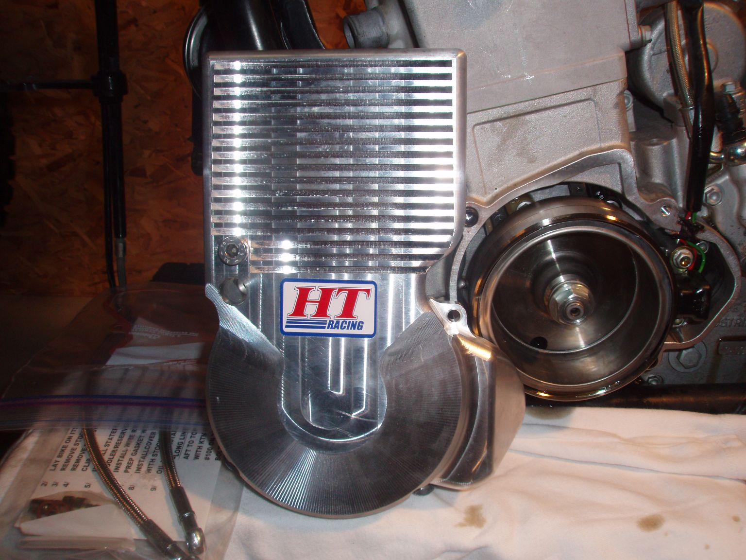 With the HT Oil Cooler the oil capacity is almost 2 quarts. Standard oil  capacity is 1.3 quarts of oil.