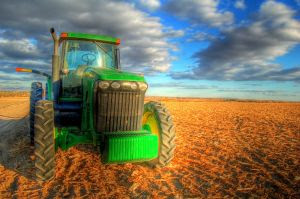 green tractor working