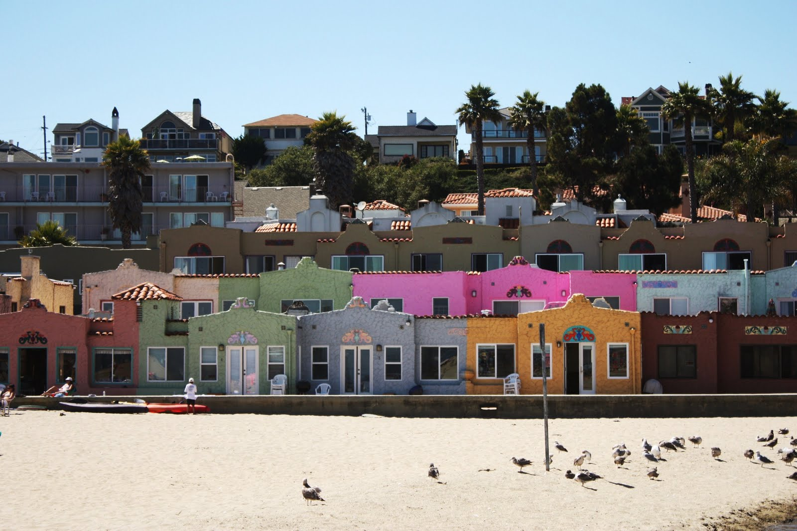 pastel colored houses took a day trip to capitola in santa cruz on sunday and the little beach town is charming the beach itself was pretty small but it