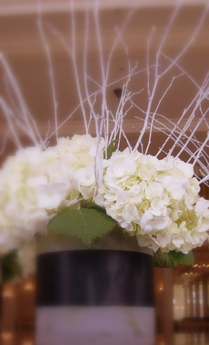 From the bridal bouquet to the smoky frost cylinder centerpieces crisp black