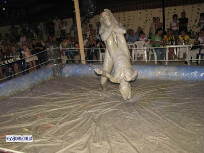 Celebrity Oops on People Festival Women Mud Wrestling