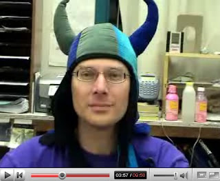 science teacher explains global warming while wearing a funny hat