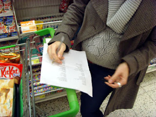 Me and bump checking off items on list - notice that we are in the 'chocolate' aisle