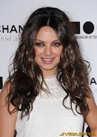 Mila Kunis in a white dress