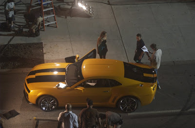 Transformers 2 - Michael Bay standing outside along with Shia LaBeouf, Isabel Lucas and the Bumblebee Camaro